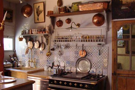 french blue and white ceramic tile backsplash black granite countertop brown tile backsplash country
