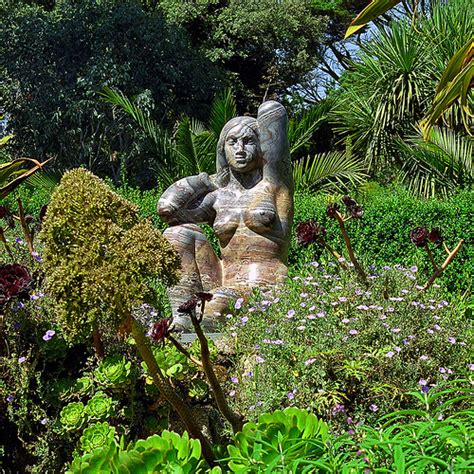 Garden Of The Goddess by Tresco Gardens Scilly Isles Uk A Statue Of The E