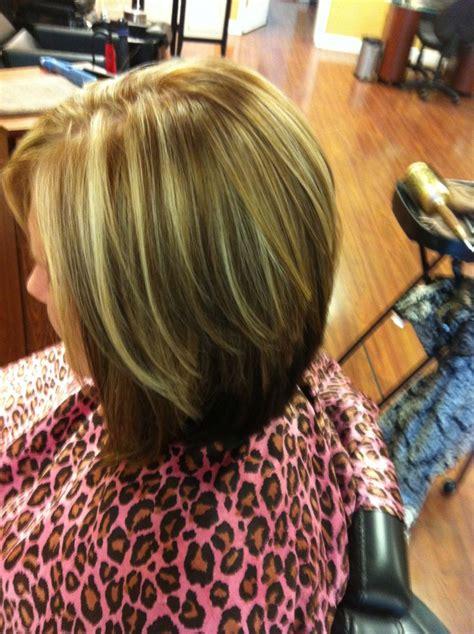 Dark brown underneath, dark blonde lowlights, bright
