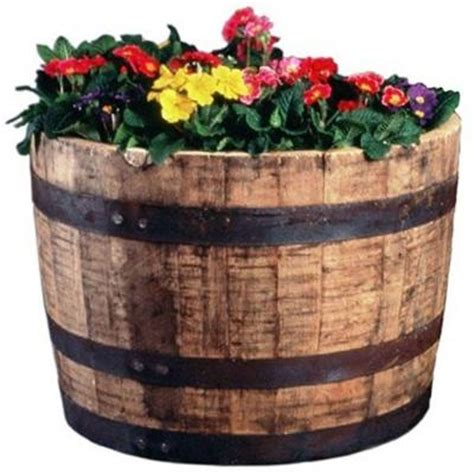 Oak Barrel Planter by 25 In Dia Oak Whiskey Barrel Planter B100 The Home Depot