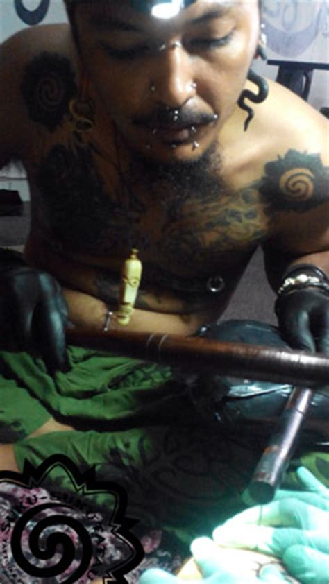 tapping tattoo bali hand tapping traditional indonesia tribe tatttoo