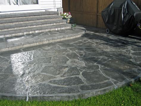 backyard flagstone rundle stone patio with charcoal grout morgan k landscapes