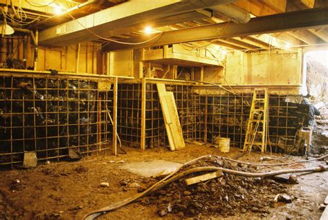 old crawl space basement prepared for final concrete wall