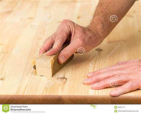 sanding woodwork mans on sanding block on pine wood stock photography
