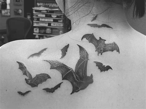 batman tattoo on back of shoulder with bats going over to 26 awesome vire bat tattoos