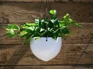 white hanging ceramic bullet planters decorate