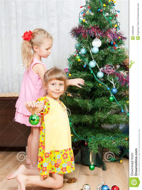 children decorate  christmas tree stock images image