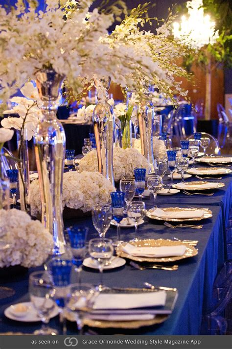 royal blue tables with pops of gold and silver featuring phalaenopsis and dendrobium orchids