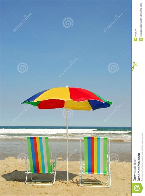 Surf The Web With The Umbrella by Chairs And Umbrella Stock Photo Image 949820