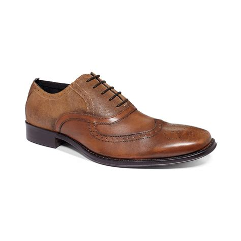 kenneth cole brown shoes lyst kenneth cole reaction trick play wingtip laceup