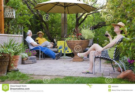Relaxing in the garden stock photo. Image of colorful