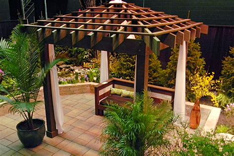 asian inspired pergola with fabric drapings landscaping