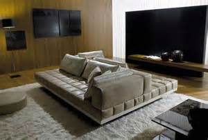 double sided couch where would you put the tv in this living room