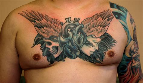 heart tattoos on chest human on chest