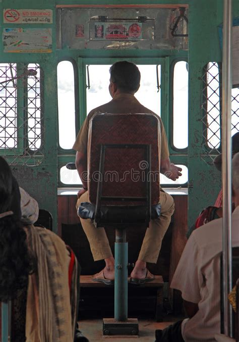boat driving license in india man is driving ferry by sea nearly kochi city india