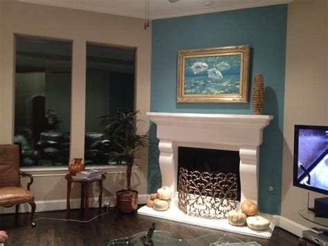 fireplace colors teal accent wall with white mantel fireplace