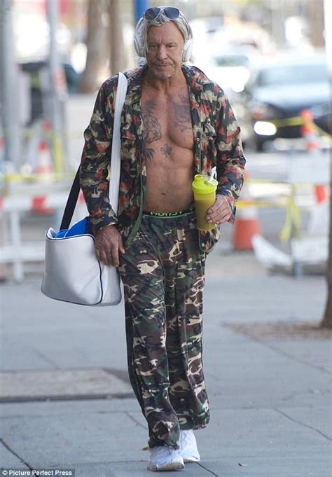 mickey rourke 65 flashes his tattoo d chest daily mail