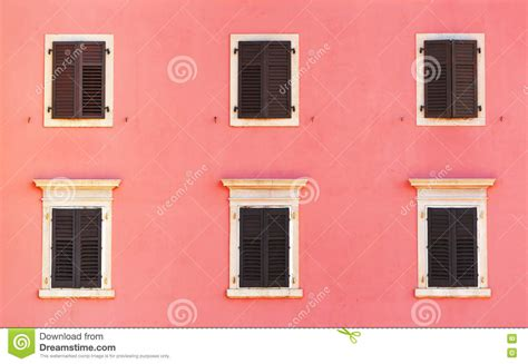 classic venetian window shapes create architecturally building facade and old windows with classic wooden