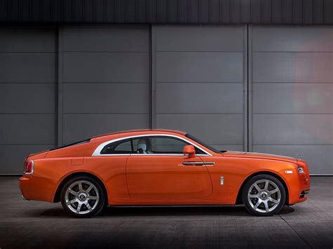 roll royce orange bespoke orange metallic rolls royce wraith revealed gtspirit