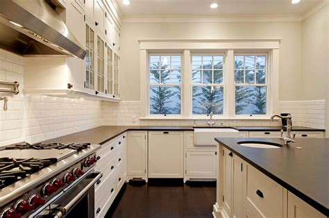 cloud white kitchen cabinets absolute black granite transitional kitchen benjamin