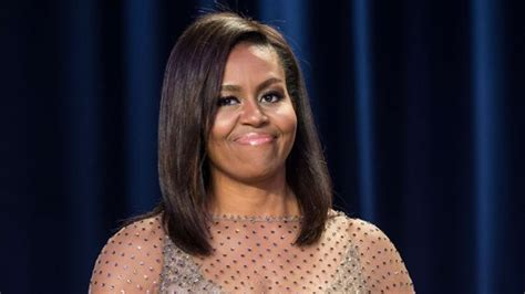 michelle obama hair loss michelle obama goes for gold in custom givenchy