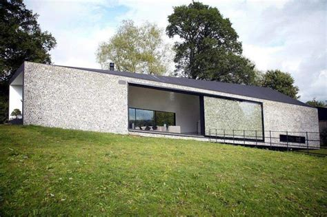 beautiful flint faced facade  amazing glass sliding door shown  grand designs uk