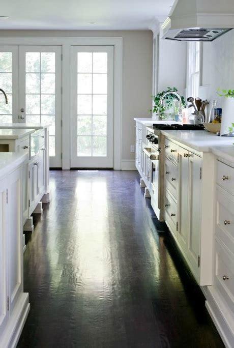 white kitchen cabinets with dark hardwood floors white kitchen cabinets with dark hardwood floors cottage