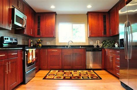 cherry red kitchen cabinets cherry shaker cabinet red oak hardwood floor black
