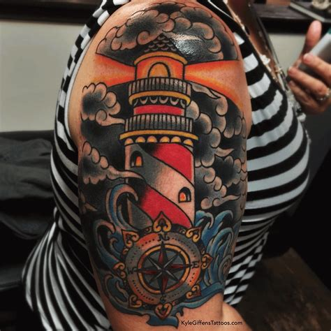 nautical compass and lighthouse tattoo on sleeve for jp