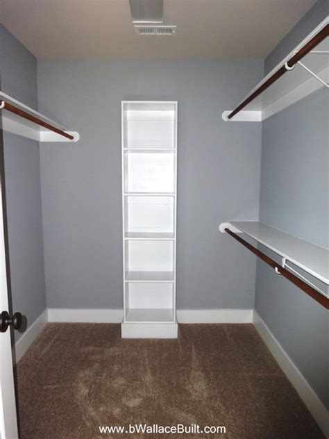 walk in closet in the master bedroom many more shelves