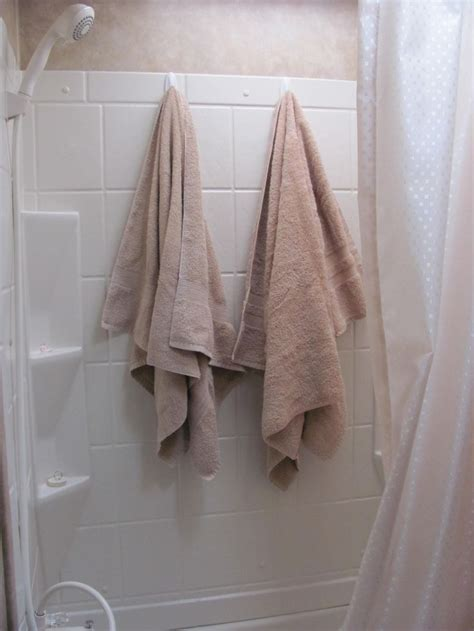 where to hang towels in a small bathroom with a family of five and a very small cer bathroom there are always wet towels or