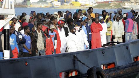 refugee boat landing in spain europe must support refugees rescue them from
