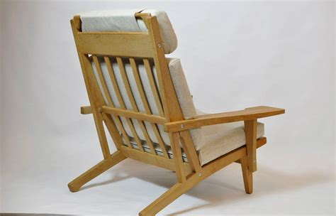 wide armchair pair of wide arm lounge chairs by hans wegner at 1stdibs