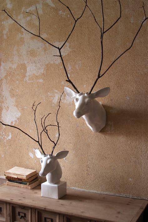 white ceramic mounted deer head