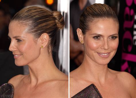 straight black hair pulled back in bun heidi klum with her hair severely pulled back into a