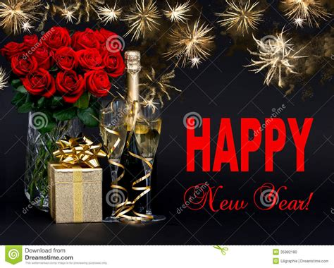 flower hd images with happy new year bottle of chagne with golden fireworks and flowers stock photo image 35982180