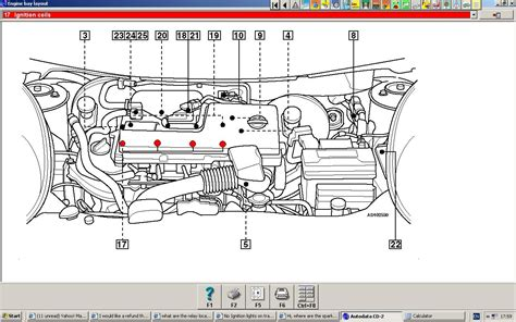 nissan the spark plugs located automatic l
