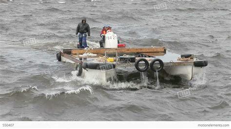 catamaran storm video two men on a motor catamaran sailing in a storm stock