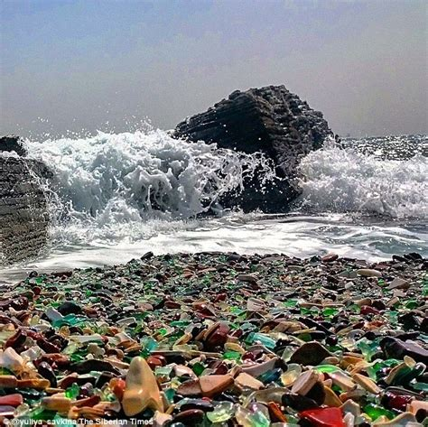 russian beaches russian dump transforms old vodka bottles into pebbles
