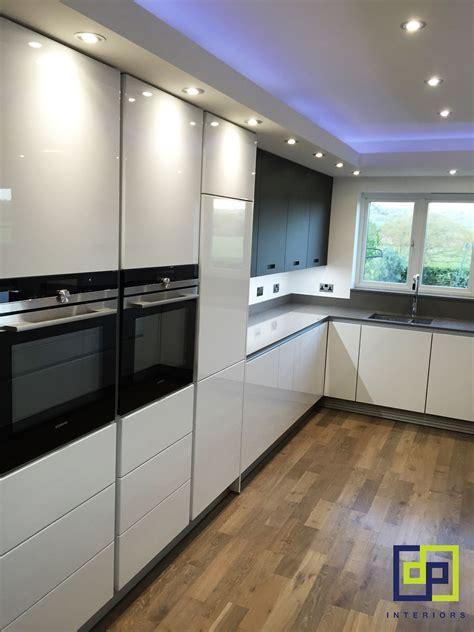 glass wall kitchen kitchen halo lighting feature white gloss and black glass