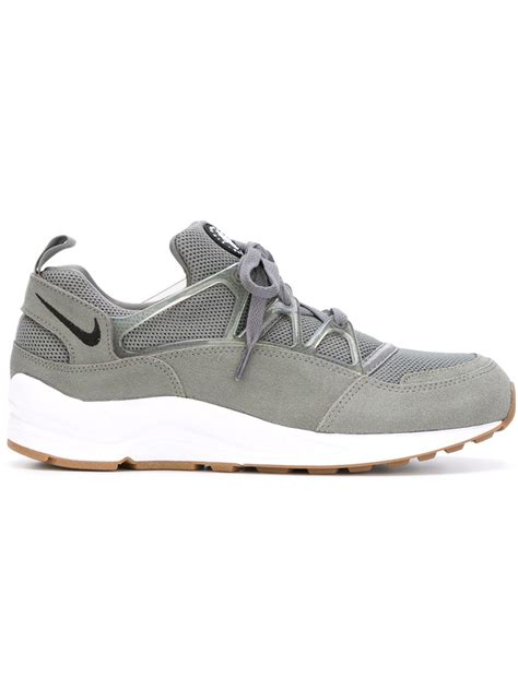 nike grey sneakers nike air huarache light sneakers in gray for lyst