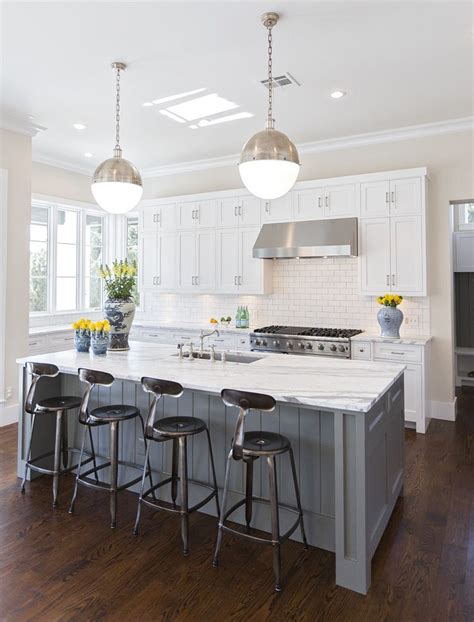 white kitchen with island hallie henley design the contrast of darker floors with white cabinets gray island is