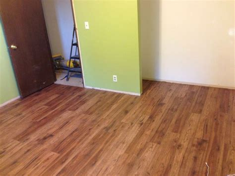 Distressed brown hickory pergo flooring and Behr's