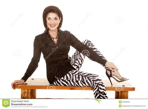 clothes her bench older woman zebra pants sit on bench smiling stock image