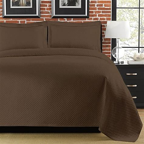 brown matelasse coverlet moved