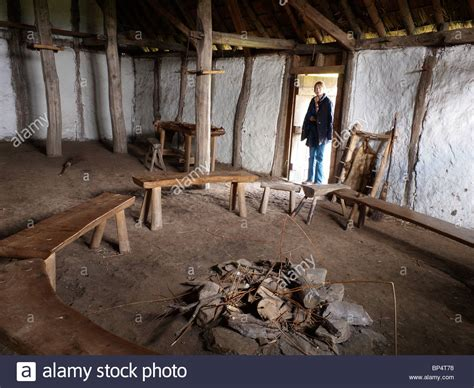 medieval house interior a woman at the door of medieval farm house interior at the