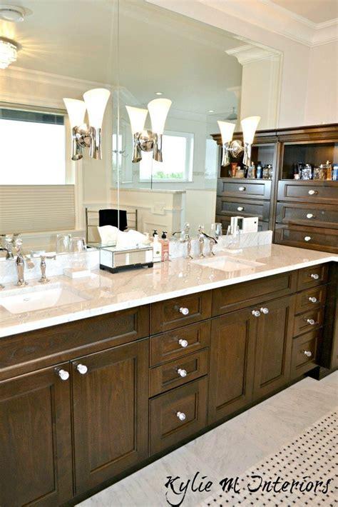 Double vanity with marble countertop, dark wood, crystal