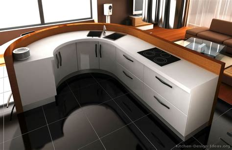 a contemporary white kitchen with curved cabinets