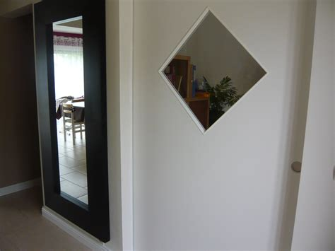 porte coulissante et grand miroir