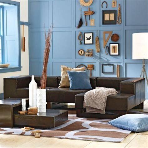 light blue and brown living room light blue accent wall and dark brown leather couch
